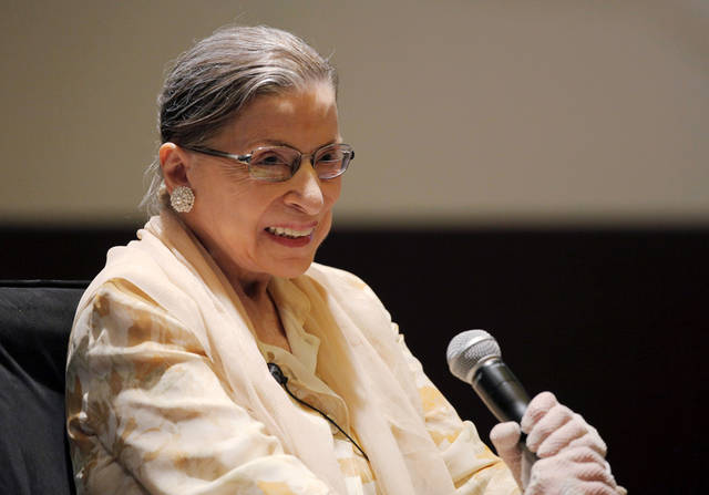 Supreme Court Justice, and opera aficionado, Ruth Bader Ginsburg participates in a panel discussion, Friday, Aug. 3, 2012, during the American Bar Association's annual meeting in Chicago. Ginsburg was joined other panelists as they listened to performances of arias in an unusual discussion of the lessons operatic performance can bring to the law. (AP Photo/Kiichiro Sato)