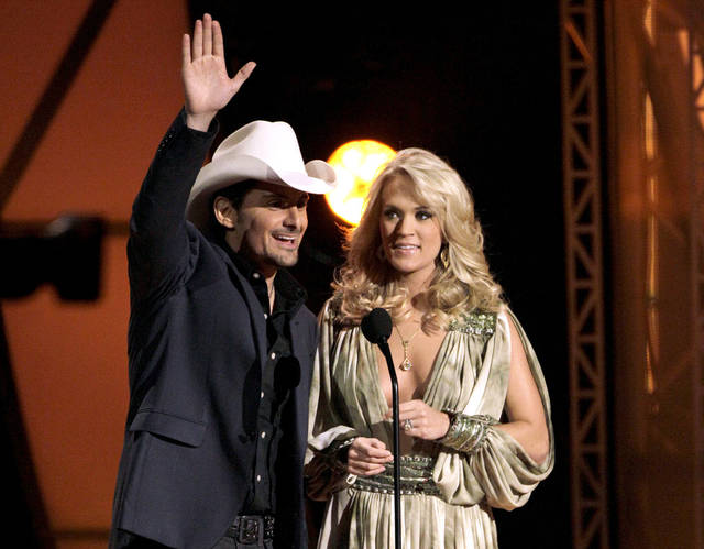 FILE - This Nov. 9, 2011 file photo shows hosts Brad Paisley, left, and Carrie Underwood speak during the 45th Annual CMA Awards in Nashville, Tenn. Underwood and Paisley have been named as hosts for the Country Music Association Awards for the fifth time. The Awards will air live on ABC Thursday, Nov. 1. (AP Photo/Mark Humphrey, file)