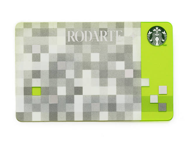 This product image released by Starbucks shows the Rodarte design Starbucks gift card, part of a series of limited-edition products for the holiday season. The card is one of several Rodarte-designed items including tote bags, cup sleeves and mug. The signature pattern features a pixelated checkerboard of gray, white and silver set against different shades of green. (AP Photo/Starbucks)