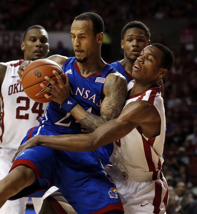 Oklahoma's Buddy Hield (3) tries to steal the ball from Kansas' Travis Releford (24) during the second half as the University of Oklahoma Sooners (OU) defeat the Kansas Jayhawks (KU) 72-66 in NCAA, men's college basketball at The Lloyd Noble Center on Saturday, Feb. 9, 2013 in Norman, Okla. Photo by Steve Sisney, The Oklahoman