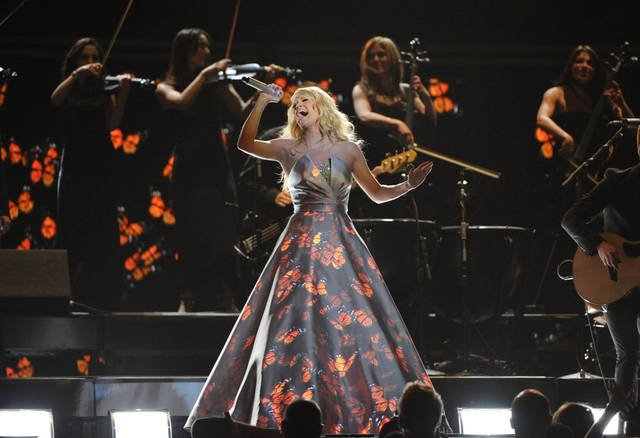 Carrie Underwood performs on stage at the 55th annual Grammy Awards on Sunday, Feb. 10, 2013, in Los Angeles. (Photo by John Shearer/Invision/AP) ORG XMIT: CAAR223