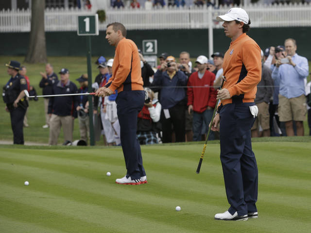 Europe's Rory McIlroy, right, and Sergio Garcia practice at the Ryder Cup PGA golf tournament Tuesday, Sept. 25, 2012, at the Medinah Country Club in Medinah, Ill. (AP Photo/David J. Phillip)