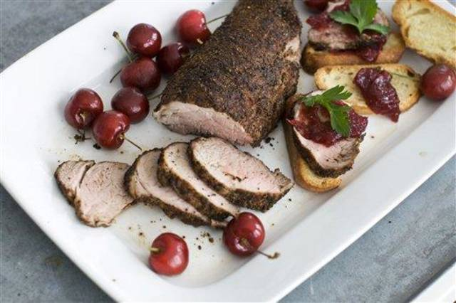 In this image taken on Jan. 28, 2013, cherry-topped coffee-roasted pork tenderloin is shown served on a platter in Concord, N.H. (AP Photo: Matthew Mead)