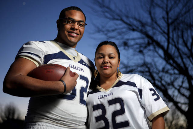 Quintaz Struble and his mother LaTisha Struble hold a football signed by his father Mandrell Dean outside their Oklahoma City home on Thursday, Jan. 12, 2012. Photo by Bryan Terry, The Oklahoman
