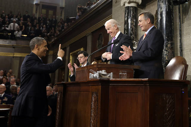 President Barack Obama gestures toward Vice President Joe Biden and House Speaker John Boehner of Ohio before giving his State of the Union address during a joint session of Congress on Capitol Hill in Washington, Tuesday Feb. 12, 2013. (AP Photo/Charles Dharapak, Pool) ORG XMIT: CAP512