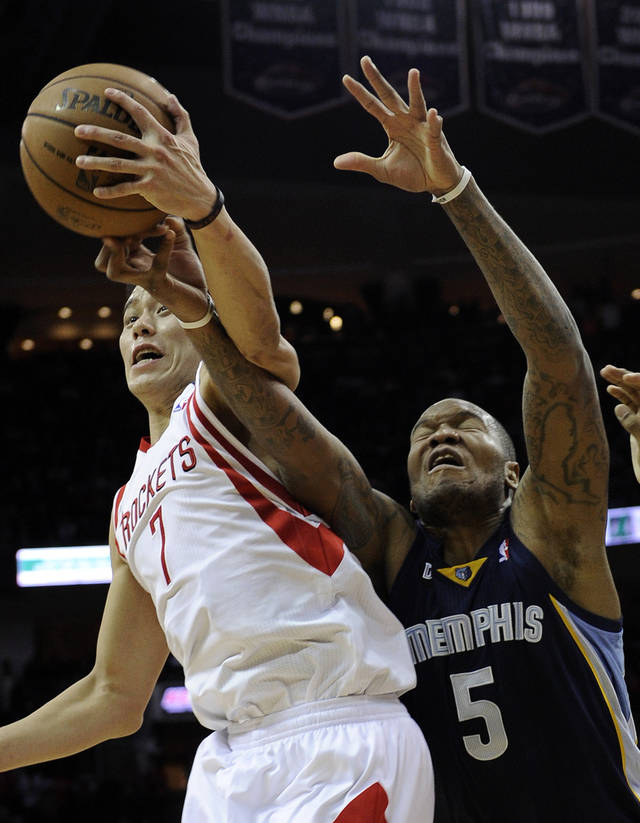 Houston Rockets' Jeremy Lin (7) knocks the ball away from Memphis Grizzlies' Marreese Speights (5) in the first half of an NBA basketball game on Saturday, Dec. 22, 2012, in Houston. (AP Photo/Pat Sullivan)