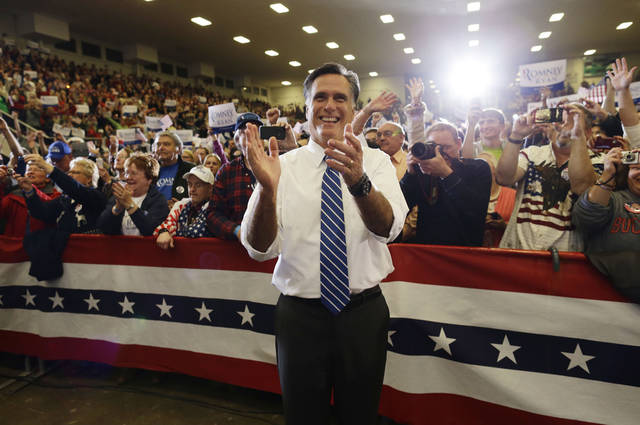Republican presidential candidate and former Massachusetts Gov. Mitt Romney applauds as he watches The Oak Ridge Boys perform as he campaign at the Veterans Memorial Coliseum, Marion County Fairgrounds, in Marion, Ohio, Sunday, Oct. 28, 2012. (AP Photo/Charles Dharapak)