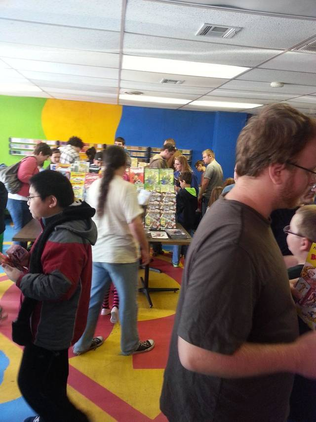 Fans picking up comics at Speeding Bullet Comics on Free Comic Book Day.