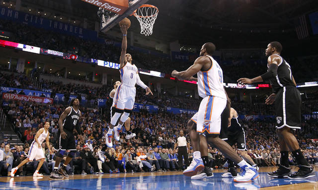 Oklahoma City's Russell Westbrook (0) drives to the basket for a layup during the NBA basketball game between the Oklahoma City Thunder and the Brooklyn Nets at the Chesapeake Energy Arena on Wednesday, Jan. 2, 2013, in Oklahoma City, Okla. Photo by Chris Landsberger, The Oklahoman