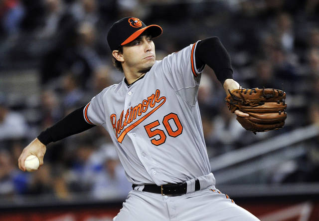   Baltimore Orioles&#039; Miguel Gonzalez delivers a pitch during the first inning of Game 3 of the Orioles&#039; American League division baseball series against the New York Yankees, Wednesday, Oct. 10, 2012, in New York. (AP Photo/Bill Kostroun)  