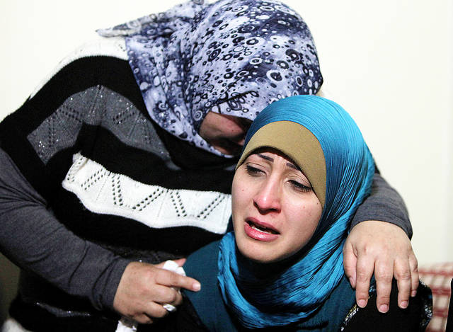 Ali Shaaban's sister, right, and a relative mourn for Shaaban on Monday at their home in Beirut. Shaaban was a television cameraman who was shot dead on Lebanon's border with Syria. AP photo