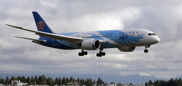 A Boeing 787 arrives Thursday, Feb. 7, 2013, at Paine Field in Everett, Wash., following a flight from Texas. The Federal Aviation Administration gave Boeing permission to relocate the plane, which was at Meacham Airport for painting when the planes were grounded last month by battery problems. (AP Photo/Elaine Thompson)