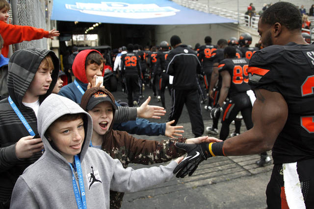 Oklahoma State's Jeremy Smith (31) greets fans at halftime during the Heart of Dallas Bowl football game between the Oklahoma State University (OSU) and Purdue University at the Cotton Bowl in Dallas,  Tuesday,Jan. 1, 2013. Photo by Sarah Phipps, The Oklahoman