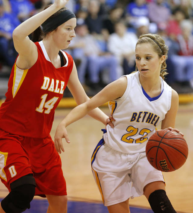 Bethel's Genna Robinson tries to get past Dale's Brayden Newton during their girls high school basketball game at Bethel High School in Shawnee, Okla., Friday, Feb. 1, 2013. Photo by Bryan Terry, The Oklahoman