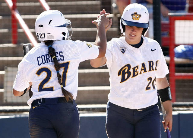 California's Valerie Arioto (20) celebrates with Cheyenne Cordes after scoring in the seventh inning against LSU during a Women's College World Series softball game in Oklahoma City, Thursday, May 31, 2012. California won 5-3. (AP Photo/Alonzo Adams)