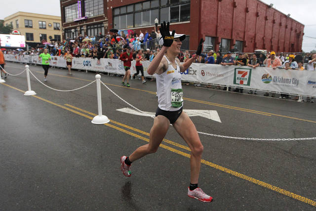 Camille Herron, the winning female, crosses the finish line during the twelfth annual Oklahoma City Memorial Marathon in Oklahoma City, Sunday, April 29, 2012.  Photo by Garett Fisbeck, For The Oklahoman