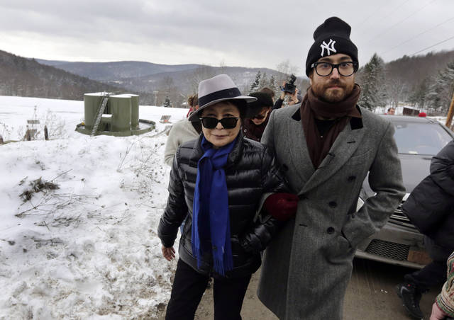 FILE - In this file photo of Jan. 17, 2013, Yoko Ono, left, and her son Sean Lennon visit a fracking site in Franklin Forks, Pa., during a bus tour of natural-gas drilling sites in northeastern Pennsylvania. Ono and Lennon have formed a group called �Artists Against Fracking,� which has become the main celebrity driven anti-fracking organization. A formal complaint filed with New York�s lobbying board asks it to investigate whether Artists Against Fracking is violating the state's lobbying law, according to the document obtained by The Associated Press. (AP Photo/Richard Drew, File)