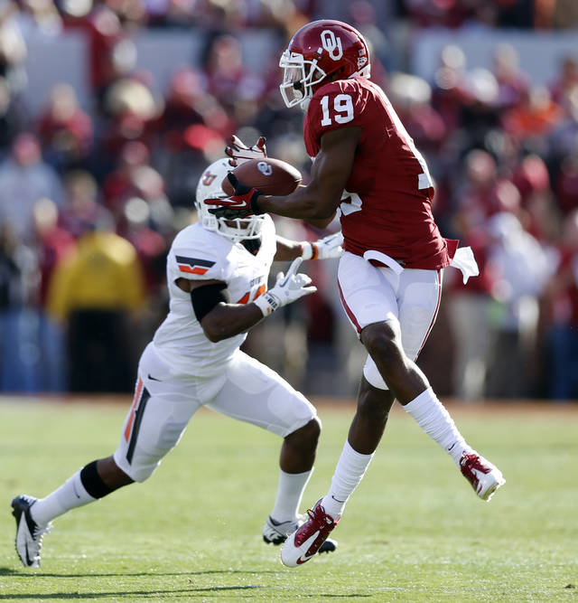 Oklahoma's Justin Brown (19) catches a pass defended by Oklahoma State's Brodrick Brown (19) during the Bedlam college football game between the University of Oklahoma Sooners (OU) and the Oklahoma State University Cowboys (OSU) at Gaylord Family-Oklahoma Memorial Stadium in Norman, Okla., Saturday, Nov. 24, 2012. Photo by Steve Sisney, The Oklahoman