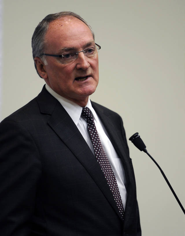 Notre Dame Athletic Director Jack Swarbrick speaks to reporters during an NCAA college football news conference regarding a hoax involving linebacker Manti Te'o on Wednesday, Jan. 16, 2013, in South Bend, Ind. Notre Dame issued a release Wednesday saying a story about Te'o's girlfriend dying, which he said inspired him to play better as he helped the Fighting Irish get to the BCS title game, turned out to be a hoax apparently perpetrated against the linebacker. (AP Photo/Joe Raymond)