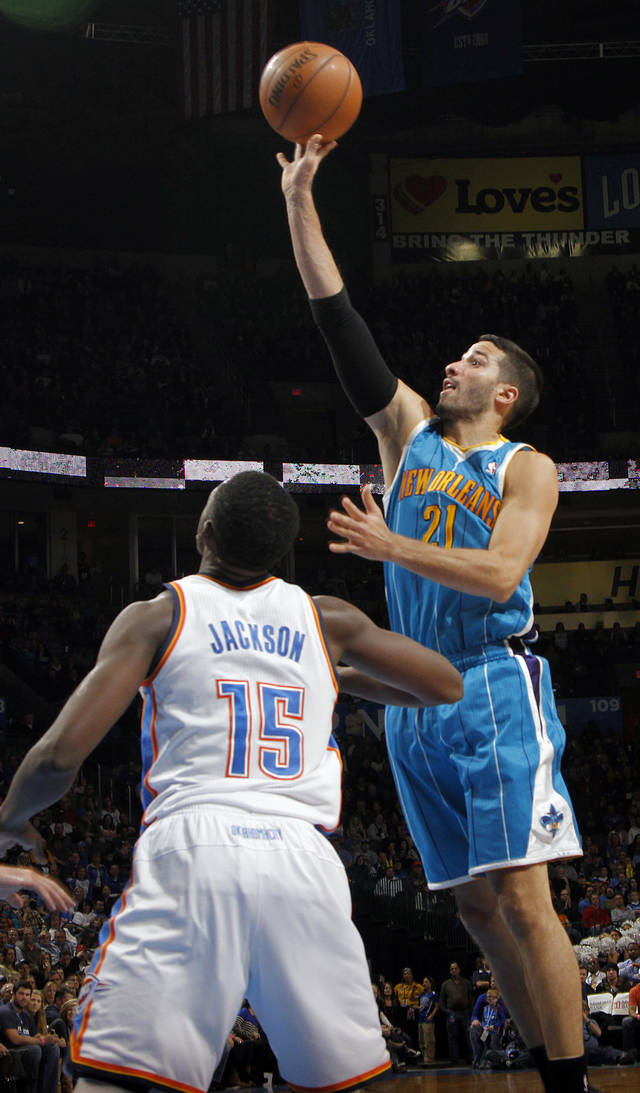 New Orleans Hornets' Greivis Vasquez (21) shoots over Oklahoma City Thunder's Reggie Jackson (15) during the NBA basketball game between the Oklahoma CIty Thunder and the New Orleans Hornets at the Chesapeake Energy Arena on Wednesday, Dec. 12, 2012, in Oklahoma City, Okla.   Photo by Chris Landsberger, The Oklahoman