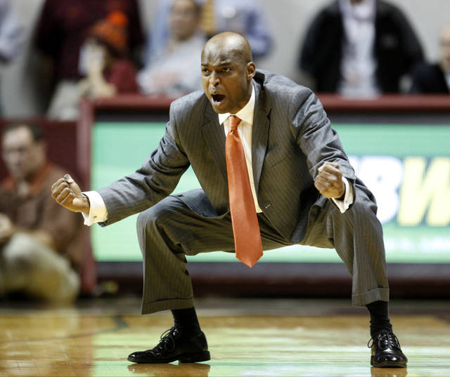 Virginia Tech head coach James Johnson yells at his team during the second half of an NCAA college basketball game against Oklahoma State in Blacksburg, Va., Saturday, Dec. 1, 2012. (AP Photo/Daniel Lin) ORG XMIT: VADL110