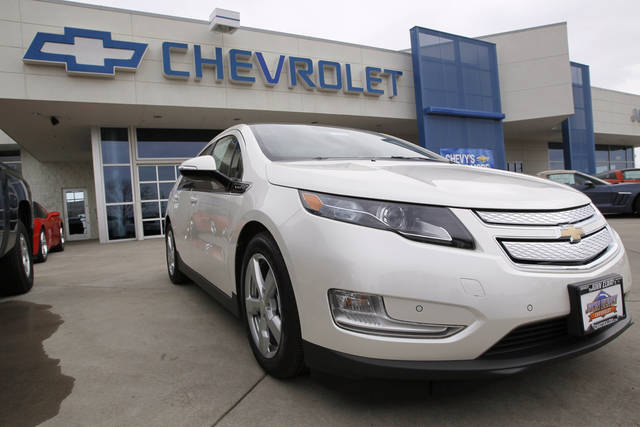 FILE - This Feb. 19, 2012 file photo, shows a 2012 Chevrolet Volt at a Chevrolet dealership in the south Denver suburb of Englewood, Colo. Sales of the Volt set a monthly record of 2,800 in August, mostly because of steep discounts. (AP Photo/David Zalubowski, File)