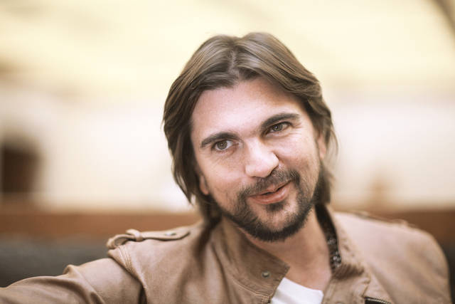 "Colombia's singer Juanes poses for photos during an interview to promote his new album ""Juanes MTV Unplugged,"" in Mexico City. Juanes says singer-songwriter-producer Juan Luis Guerra got him out of his comfort zone when the famed musician started rearranging his songs for his ""MTV Unplugged"" taping. The singer said the 14 songs on ""Juanes: MTV Unplugged,"" released this week, is a blend of Latin, jazz, blues, rock, folk and classic sounds. AP Photo"