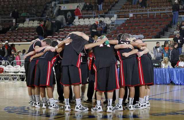 The Carnegie Wildcats huddle up at mid court during the first round 2A boy's State Basketball Championship game between Preston High School and Carnegie High School at the State Fair Arena on Thursday, March 8, 2012 in Oklahoma City, Okla.  Photo by Chris Landsberger, The Oklahoman