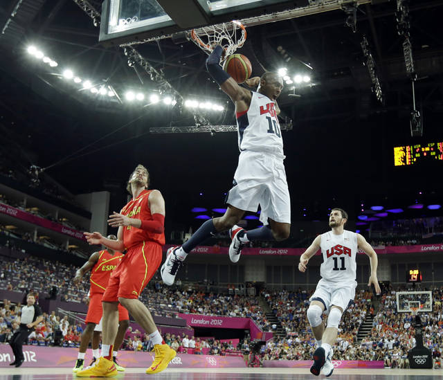 United States' Kobe Bryant reacts after a dunk during a men's gold medal basketball game against Spain at the 2012 Summer Olympics, Sunday, Aug. 12, 2012, in London. AP photo