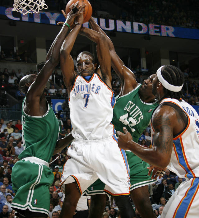 Oklahoma City&#039;s Joe Smith, middle, tries to grab a rebound between Boston&#039;s Kevin Garnett, left, and Kendrick Perkins as Oklahoma City&#039;s Chris Wilcox looks on in the first half during the NBA basketball game between the Oklahoma City Thunder and the Boston Celtics at the Ford Center in Oklahoma City, Wednesday, Nov. 5, 2008. BY NATE BILLINGS, THE OKLAHOMAN