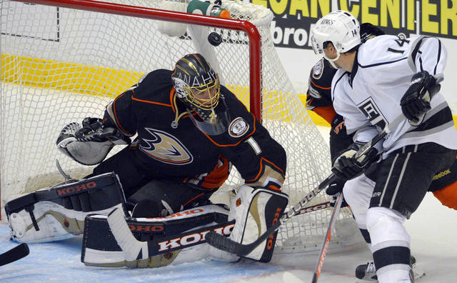 Los Angeles Kings right wing Justin Williams, right, scores on Anaheim Ducks goalie Jonas Hiller, of Switzerland, during the second period of their NHL hockey game, Saturday, Feb. 2, 2013, in Anaheim, Calif. (AP Photo/Mark J. Terrill)