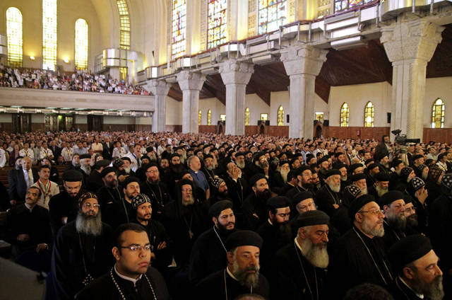   Egyptian Copts attend mass prior to a ceremony to chose the new Coptic pope in Cairo&#039;s main Coptic cathedral. Egypt&#039;s ancient Coptic Christian church named a new pope on Sunday, Nov. 4, 2012 to spiritually guide the community through a time when many fear for their future with the rise of Islamists to power and deterioration in police powers after last year&#039;s uprising. (AP Photo/Roger Anis, El Shorouk Newspaper) EGYPT OUT  