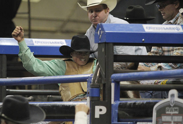Hardy Braden, of Welch, Okla., prepares in the shoot to compete in saddle bronc riding during the Ram National Circuit Finals Rodeo at the State Fair Arena in Oklahoma City, Saturday, March 31, 2012.  Photo by Garett Fisbeck, For The Oklahoman