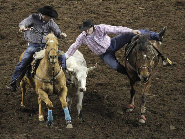 Cody Mousseau, of Canada, competes in Steer Wrestling during the final performance of International Finals Rodeo at the State Fair Arena in Oklahoma City, Okla., Sunday, Jan. 20, 2013.  Photo by Garett Fisbeck, For The Oklahoman