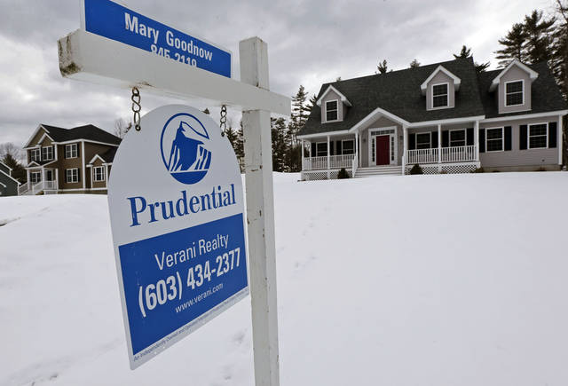 In this Tuesday, March 5, 2013, photo, a home is for sale in Auburn, N.H.  Standard & Poor's/Case-Shiller reports on home prices in February on Tuesday, April 30, 2013. (AP Photo/Charles Krupa)