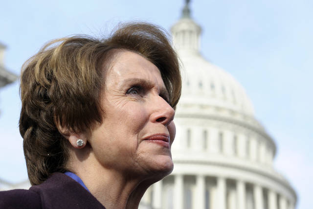 House Minority Leader Nancy Pelosi of Calif. is seen on Capitol Hill in Washington, Thursday, Jan. 3, 2013, as she poses with female House members prior to the officially opening of the 113th Congress. (AP Photo/Cliff Owen)