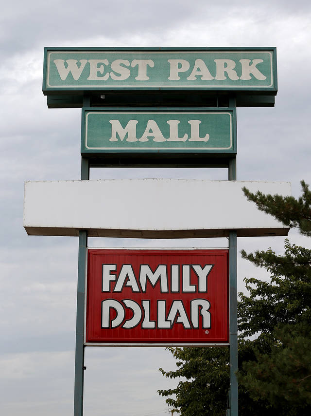 The mid-1970s lettering on the West Park Mall sign is an indication that the property has not seen much in the way of improvement since it was built in 1974. The new owner plans to redevelop the 124,955-square-foot shopping center into new retail at NW 63 and MacArthur Boulevard in Warr Acres. <strong>BRYAN TERRY - THE OKLAHOMAN</strong>
