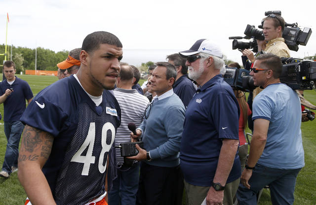 Chicago Bears tight end Evan Rodriguez walks away after talking to reporters after the NFL football team's practice Tuesday, June 4, 2013, in Lake Forest, Ill. Authorities say Rodriguez was ticketed for driving under the influence, speeding and improper lane usage and was ticketed early Friday on Interstate 90, near downtown Chicago. The incident was the second encounter the 24-year-old Rodriguez has had with police this year. In March, Rodriguez was charged with disorderly intoxication and resisting an officer in Miami. Those charges were eventually dropped. (AP Photo/Charles Rex Arbogast)