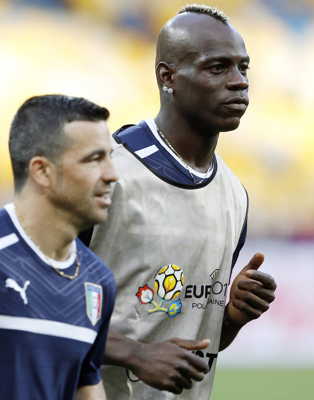 Italy's Mario Balotelli, right, runs alongside his teammate Antonio Di Natale during a training session on the eve of the Euro 2012 soccer quarterfinal match between England and Italy in Kiev, Ukraine, Saturday, June 23, 2012. (AP Photo/Gregorio Borgia)
