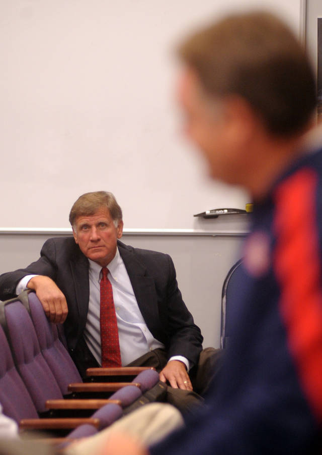 "Mississippi athletic director Pete Boone listens as head coach football coach Houston Nutt speaks about the football program during a press conference in Oxford, Miss. on Monday, Sept. 19, 2011. Mississippi has started the season 1-2, including a 30-7 loss to Vanderbilt on Saturday, Sept. 17, 2011 that Boone termed ""unacceptable."" (AP Photo/Oxford Eagle, Bruce Newman)"