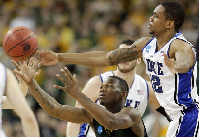 Baylor's LaceDarius Dunn, left, and Duke's Lance Thomas (42) battle for a rebound during the second half of the NCAA South Regional college basketball championship game in Houston, Sunday, March 28, 2010. AP PHOTO