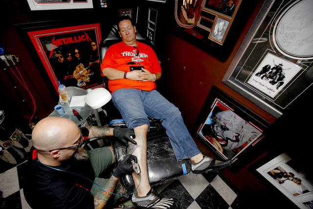 Chris Zamorano of Oklahoma City gets a free Thunder tattoo from Josh Poindexter of Tornado Tattoo in Oklahoma City, Friday, June 8, 2012. Photo by Bryan Terry/The Oklahoman