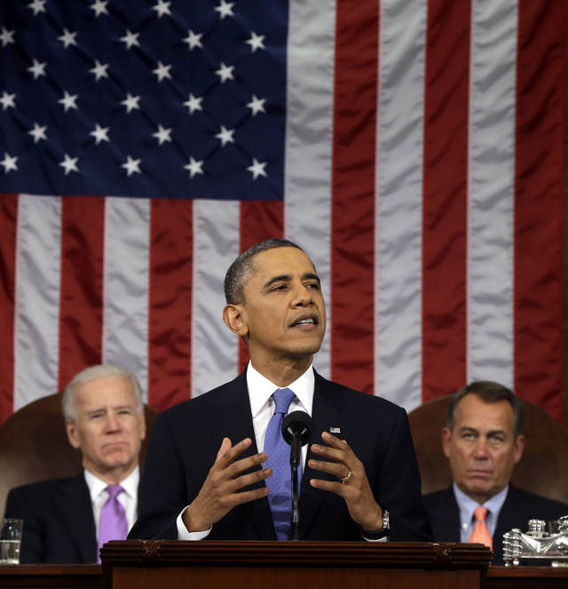 President Barack Obama, flanked by Vice President Joe Biden and House Speaker John Boehner of Ohio, gestures as he gives his State of the Union address during a joint session of Congress on Capitol Hill in Washington, Tuesday Feb. 12, 2013. (AP Photo/Charles Dharapak, Pool) ORG XMIT: CAP516
