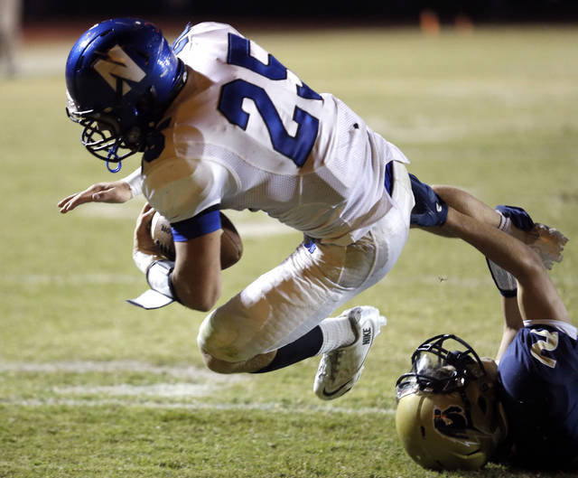 Newcastle's Zach Bergt scores a touchdown against Heritage Hall's Truitt Maxwell during the high school football game between Heritage Hall and Newcastle at Heritage Hall High School, Thursday, Oct. 10, 2013, in Oklahoma City. Photo by Sarah Phipps, The Oklahoman