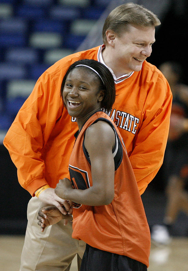 OSU head coach Kurt Budke laughs with Andrea Riley during practice inside the New Orleans Arena in New Orleans, Friday, March 28, 2008.  Oklahoma State University will play LSU in the regional semifinals of the NCAA women's college basketball tournament Saturday.   BY BRYAN TERRY, THE OKLAHOMAN