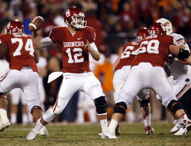 Landry Jones makes a throw during the second half of the Bedlam college football game in which  the University of Oklahoma Sooners (OU) defeated the Oklahoma State University Cowboys (OSU) 51-48 in overtime at Gaylord Family-Oklahoma Memorial Stadium in Norman, Okla., Saturday, Nov. 24, 2012. Photo by Steve Sisney, The Oklahoman
