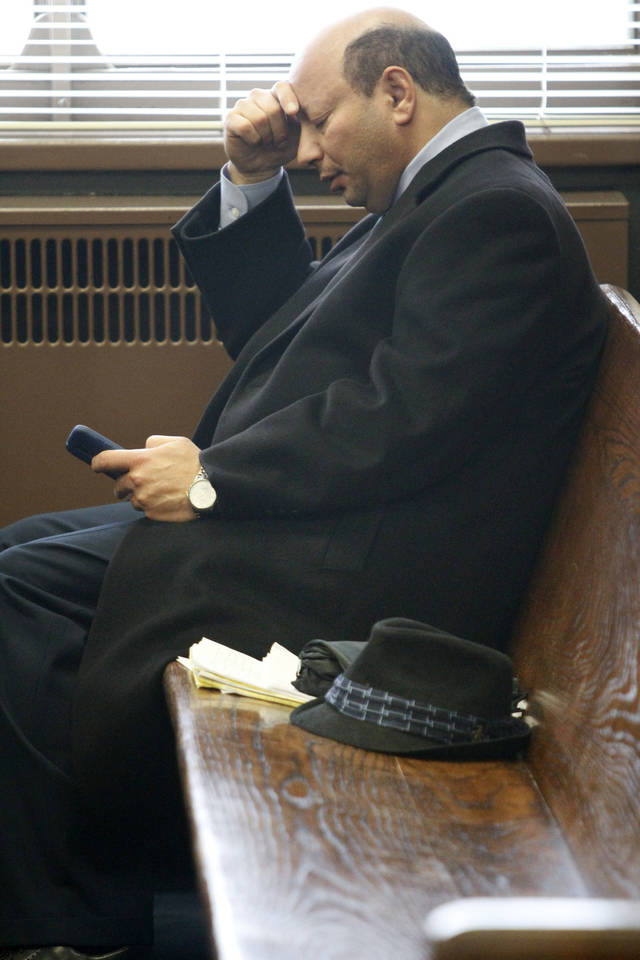 Dr. Medhat Michael waits for his hearing to start Wednesday at the Oklahoma County Courthouse in Oklahoma City. PHOTO BY STEVE GOOCH,  THE OKLAHOMAN