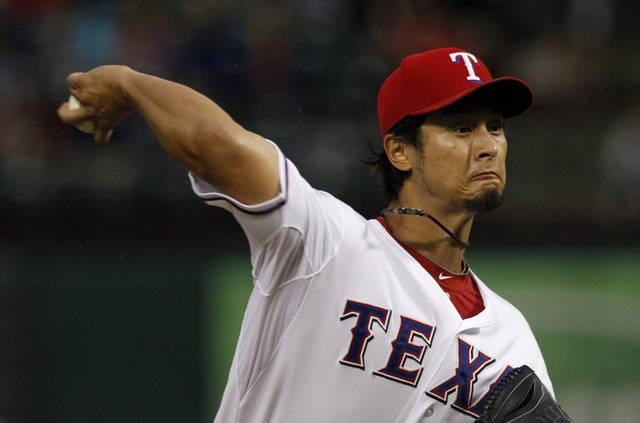 Texas Rangers starting pitcher Yu Darvish of Japan delivers to the Seattle Mariners in the first inning of a baseball game Friday, Sept. 14, 2012, in Arlington, Texas. (AP Photo/Tony Gutierrez)