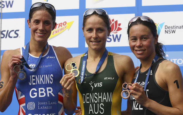 The medal winners, Australia's Erin Densham, center, Britain's Helen Jenkins and New Zealand's Andrea Hewitt, right, from the elite women at the ITU World Triathlon Series show their medals in Sydney, Australia, Saturday, April 14, 2012. Densham won gold, Jenkins took silver and Hewitt took the bronze. (AP Photo/Rick Rycroft)