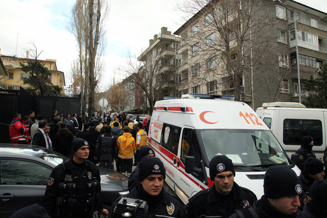 Emergency personnel block an entrance of the U.S. Embassy in the Turkish capital, Ankara, after a suspected suicide bomber detonated an explosive device, Friday Feb. 1, 2013. The bomb appeared to have exploded inside the security checkpoint at the entrance of the visa section of the embassy. A police official said at least two people are dead. (AP Photo/Burhan Ozbilici)